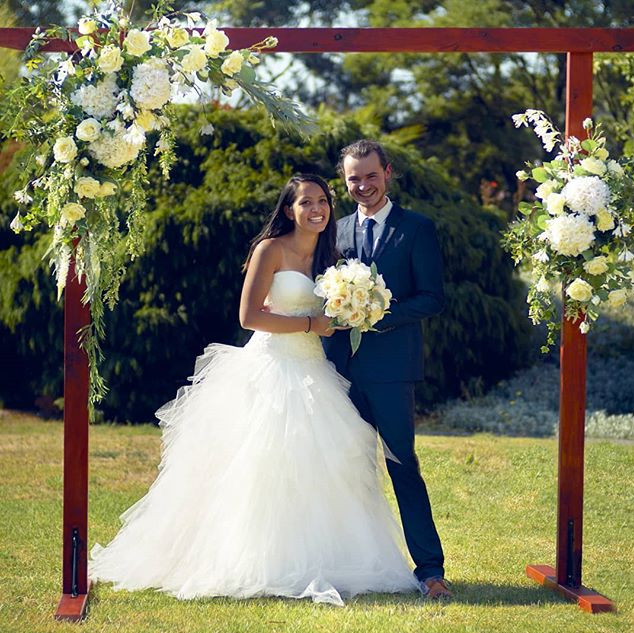 Wooden arch with ivory florals