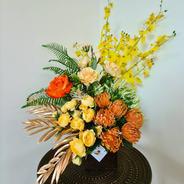 Yellow and orange faux flower arrangement.