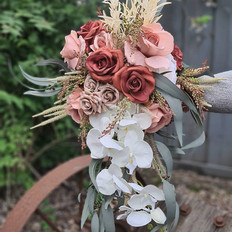 Modern coffee and late coloured orchid cascading bridal bouquet
