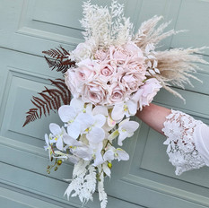 Modern style bohochic bridal bouquet with real touch roses.