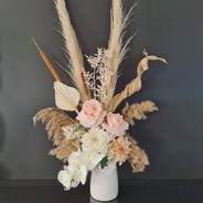 Dried and faux flower arrangement in neutral tones.