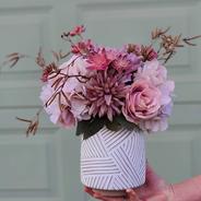 Small mauve arrangement. Mauve roses, astrantia, Chrysanthemum, hydrangeas and birch.