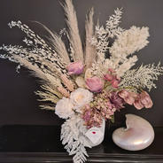 Faux and preserved arrangement. Mauve roses cream roses, mauve bell flowers, mauve hydrangea. Preserved pampas, ruscus, feather fern and grasses.