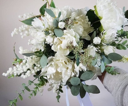 White and green free-flow silk bridal posy.