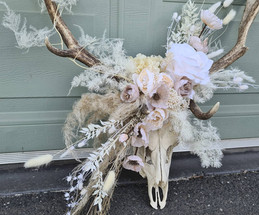 Dried and preserved adornment on client's own deer antlers.