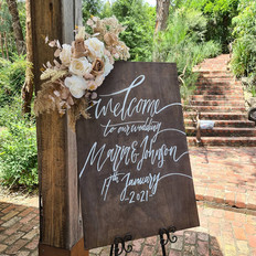 Welcome sign flowers to match your theme.