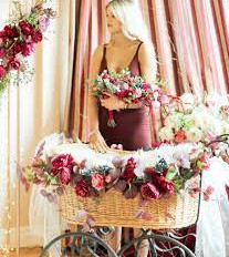 Bassinet with burgundy florals and white chiffon.