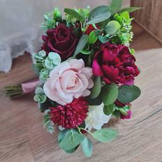 Faux burgundy and blush wedding posy.