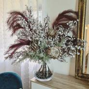Faux flower arrangement in glass vase.