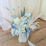 Welcome baby boy arrangement. Light blue orchids, blue bunny tales and blue and white roses and hydrangeas.