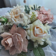 Pretty artificial all round arrangement in toffee and cream colours.