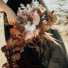 coffee neutral bohochic Modern bridal cascading teardrop bouquet.
