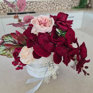Artificial all round arrangement in burgundy and blush.