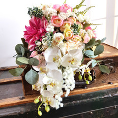 Artificial cascading bridal bouquet in pinks and orchids.