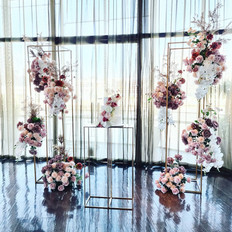 Gold stands with floral clouds. Blush pink and orchids.