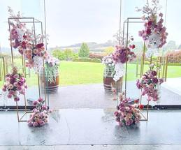 Floral plinths and barrel arrangements. Ceremony setup.