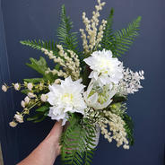 Small arrangement with white faux dahlias, fernleaves, wattle, white protea and buttons.