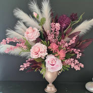 Faux arrangement in champagne coloured urn.