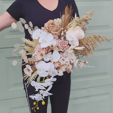 Faux and preserved mix for this modern bridal bouquet using a neutral tone all over.