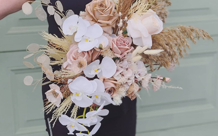 Faux and preserved cascading freeflow bridal bouquet.