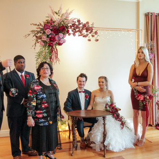 wedding setup with copper arch and bassi