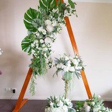 Triangle arbor with white and green tropical florals