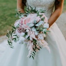 Faux blush pink free-flow bridal bouquet in relaxed design.