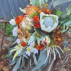 Faux wedding bouquet. Slight cascading in burned orange and white.