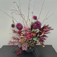 Deep mauve moody arrangement. Fantasy plum balls, twigs, burgundy ferns, dried roses, spike balls, burgundy gum leaves, orange fern spray, black lace fern.