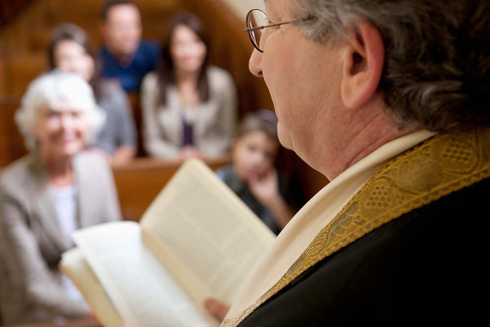 """A Pastor speaking to his congregation, cover photo for the """"How to Discern if a Doctrine is True"""" blog, from the Paradise Explained Series at Paradise Ministries."""