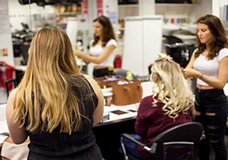 Hairdressers working in a salon