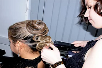A woman having her hair styled