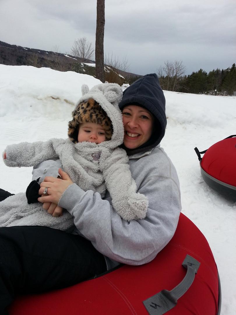 Jaime sliding with baby Zoe