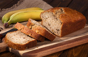 Banana nut sweet bread sliced on a woode