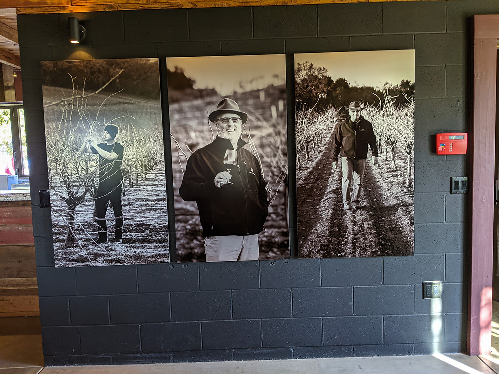 Photos hang at Lone Madrone Winery. Neil Collins (center) is winemaker at Lone Madrone and Tablas Creek
