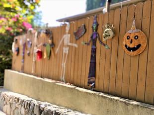 halloween decorated wood fence.jpeg
