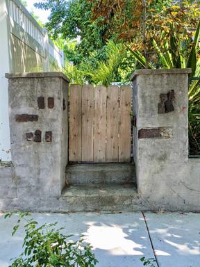 Wooden gate cement steps.jpeg