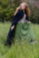Red-haired 18th century woman in a field