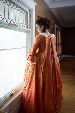 A young woman in historical clothing in