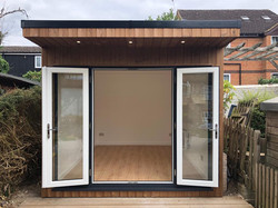 Small garden office with french doors