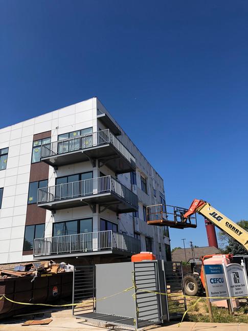 Wrap around balconies being installed.