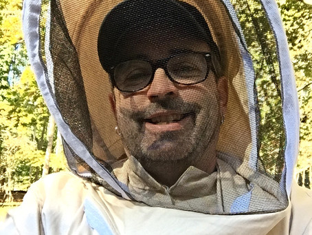 College instructor, Marek McKenna, buzzes about as a beekeeper