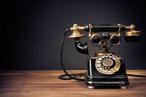 Vintage old telephone with binoculars conceptual still life.jpg