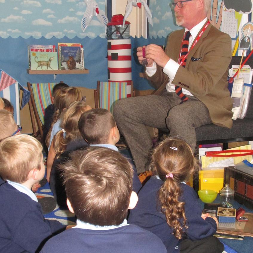 Spyke shows the children a replica VC