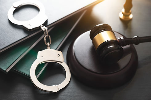 Handcuffs and wooden gavel. Crime and vi
