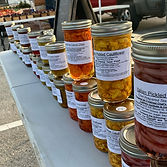 Ah something different. Canned goods jarred and lined up in fall colors like red, yellow and orange.