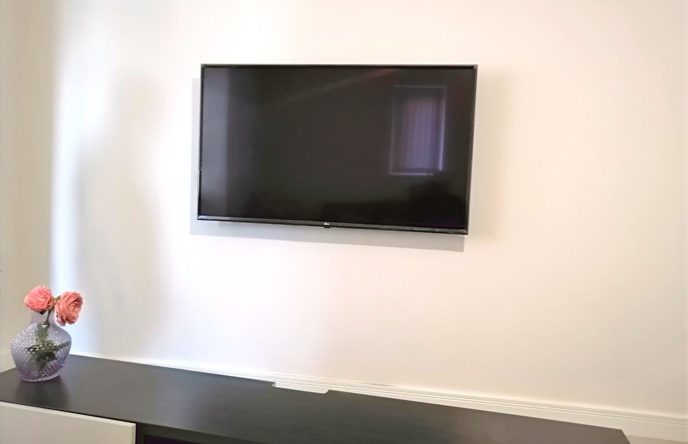 TV Wall Mounted in a Kitchen
