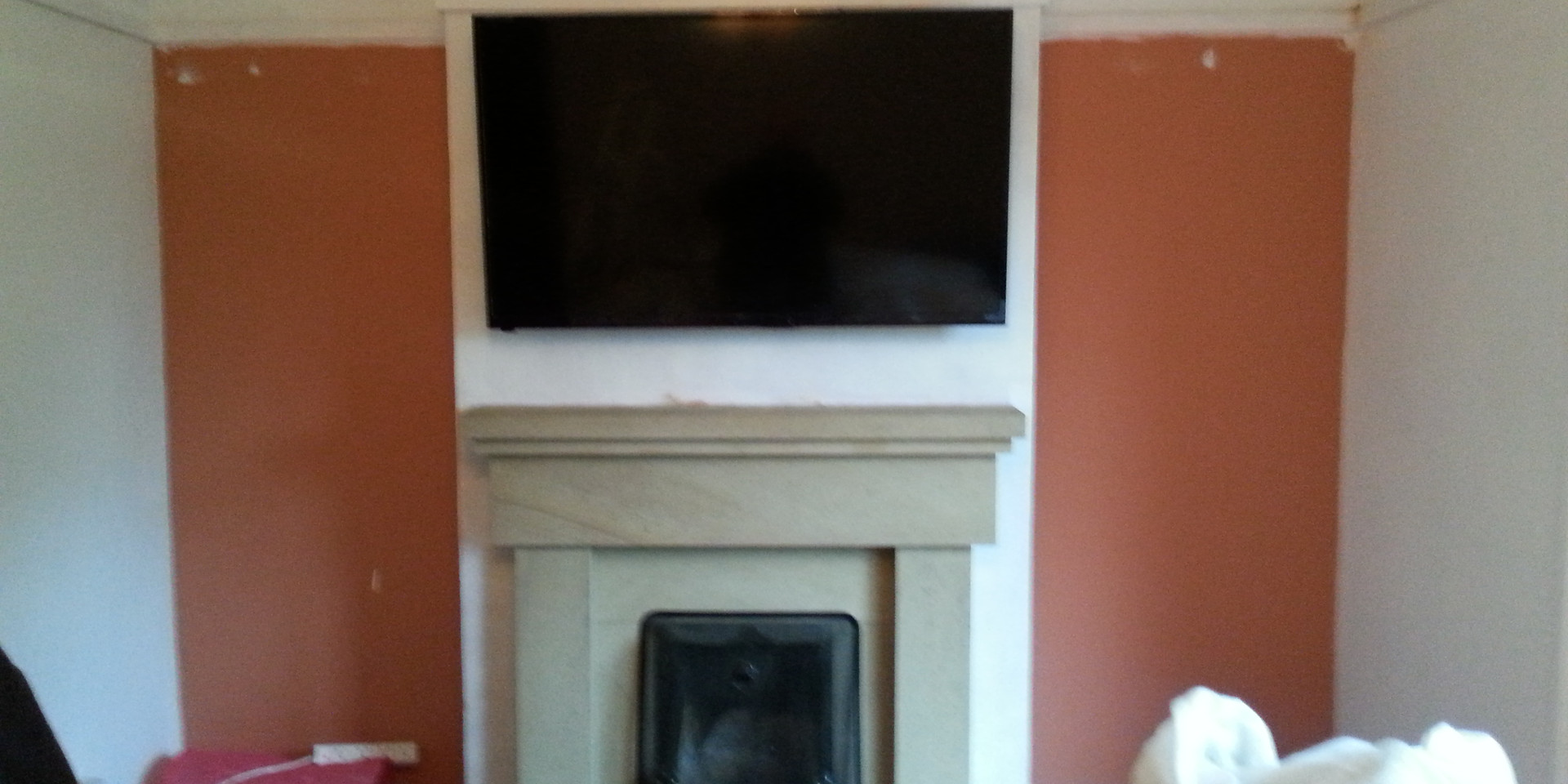 TV wall mounted above a fire place