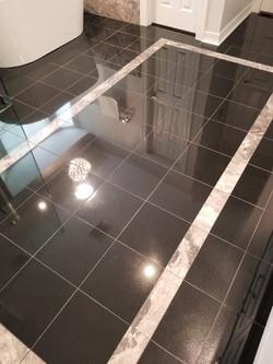 Granite floor in modern bathroom