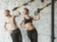 Young sporty couple workout in gym.jpg